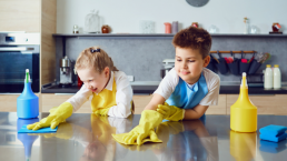 Kids Cleaning A Kitchen
